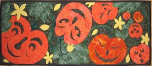 "14"" x 35"" Table Runner Table runner Machine applique Works well on a door too especially on Hallowe'en ©Copyright, 2002, Pat Daniels"