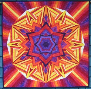 "40"" x 40"" Wall hanging Based on book and featured on the last page of the Gallery section of ""Ricky Tims' Kool Kaleidoscope Quilts"" ©Copyright, 2010, Pat Daniels"
